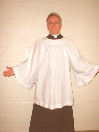 Picture of a cassock and surplice combination